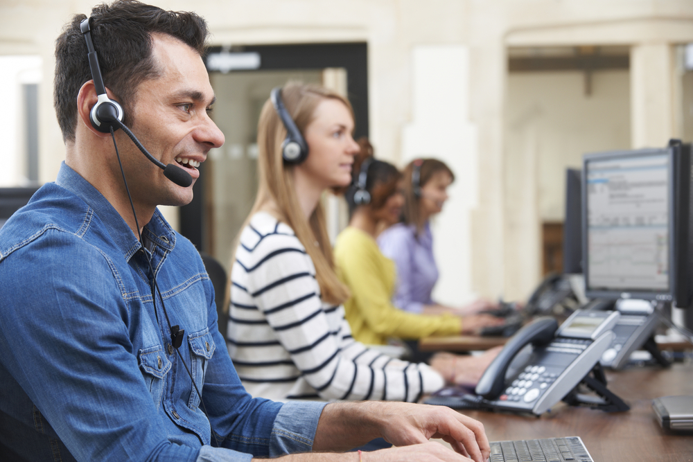 customer service team using headsets at office