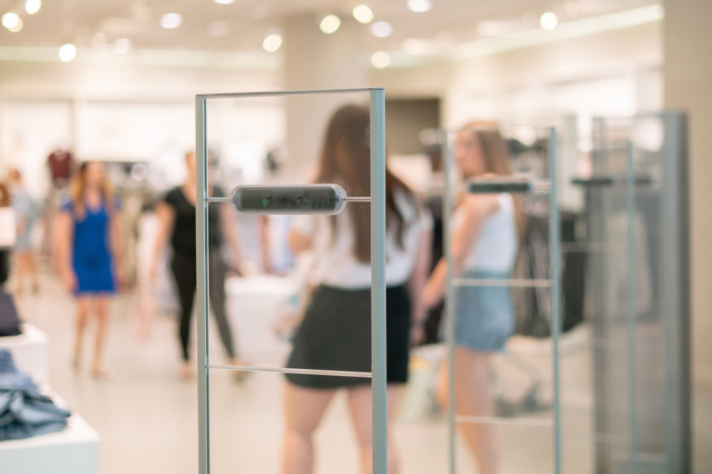 retail shoppers passing through EAS system
