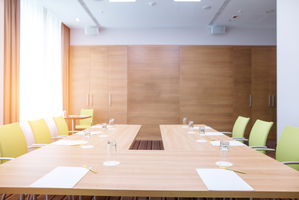 empty and modern conference room with bright green chairs